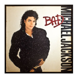 """Glittered Michael Jackson BAD Album - Glittered record album. Album is framed in a black 12x12"""" square frame with front and back cover and clips holding the record in place on the back. Album covers are original vintage covers."""
