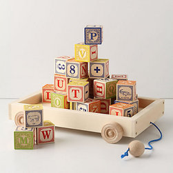 Alphabet Wagon - This vintage-like wooden alphabet set (with those adorable embossed alphabet blocks) is just the type of toy that you purposefully want to leave out.