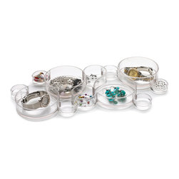 Keepsake Accessory Storage Tray - Group together several of these round acrylic trays in your bathroom or dresser drawer to neatly hold bracelets, rings, necklaces and more jewelry.
