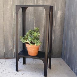 Garden Accents and Accessories - Industrial style black metal shelf happily supports your potted plants or whatnots on the patio or in the house.  Example of many shelving and occasional tables we get in.   See our website for pricing and more items for sale.