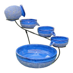 Smart Solar - Blueberry Ceramic Solar Cascade - with Rustic Blue finish - Blueberry Ceramic solar powered 4 tier cascading fountain with Rustic Blue finish. Creates a relaxing atmosphere on your patio, deck, balcony or in your garden. Recycles water from the main bowl reservoir. Operates in direct sunlight. Powered by a separate solar panel with a 10 ft cable. Low voltage pump with filter. No wiring, simply install and enjoy. No operating costs.