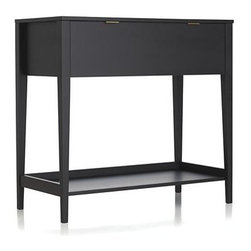 Wentworth Secretary - Clean-lined desk only looks like a console table, cleverly unfolding to a trusty secretary desk. Designed for us by Mark Daniel, this tidy design contrasts a matte black exterior with a neat white interior, tasked to store office essentials on tidy shelves and a pull-out drawer. Large bottom shelf can hold a printer or store entryway items.  A great small-space solution for office, bedroom or foyer.