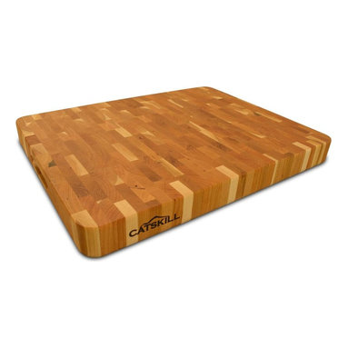 Catskill Craftsmen - Butcher Block - 14.5-inch x 19-inch End Grain - Constructed in an end grain design that won't dull knives, this beautiful chopping block will easily enhance your kitchen decor. Ideal for vegetables, herbs, meats and more, the reversible block is constructed of hardwoods and features finger slots for easy handling. Butcher Block Collection. Made of US hardwood. End grain won't dull knives. Reversible. Finger slots for easy handling. Made in the USA. 14.5 in. L x 19 in. W x 2 in. H (15 lbs.)