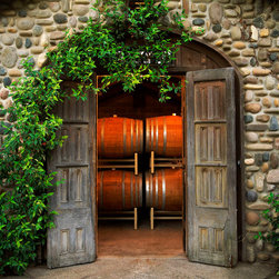 Murals Your Way - The Barrel Room Wall Art - This beautiful mural would work well in the dining room of a wine lover. It features a pair of aged doors opening in the arch of a stone wall