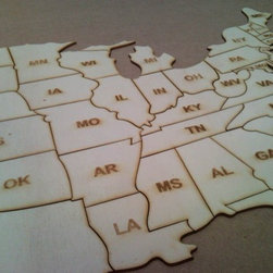 United States of America Wood Puzzle by Greek Art - This large wood puzzle of the United States is an easy way for young kids to learn the different states. The plywood is easy to paint with acrylic paints, so you can paint your state a special color or have fun painting the states you've traveled.