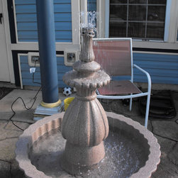 """3 Tier Water Fountain - I have created this using random items that matched. The base is an old fiber glass planter. The top separates for storage and moving. I used an old terra cotta pot upside down and a ceramic lamp that I cut the top off and set ontop of the pot. Then I used a small porcelene vase to top it off. I drilled through the center and put a brand new pump under the pot. This beautiful piece stands 42"""" tall with a 36""""ound base. I applied a rich stone finish then sealed it with Marine urathane."""