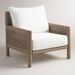 World Market - All-Weather Wicker Vailea Outdoor Occasional Armchair - The open basket weave of our chair lends a casual, relaxing air to your deck or patio. In a clean silhouette with thick, round pole legs, this outdoor seating option includes a plush, 100% polyester seat and back cushion for ultimate comfort.