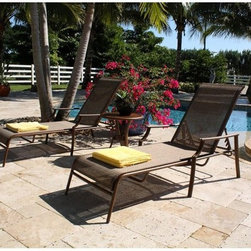 Chub Cay - Hospitality Rattan Chub Cay 3 Piece Patio Sling Chaise Lounge Set - Dark Bronze - Shop for Chaise Lounges from Hayneedle.com! Settle into the Hospitality Rattan Chub Cay 3 Piece Patio Sling Chaise Lounge Set - Dark Bronze alone or with a friend and you'll be all set for relaxation like never before. Showcasing a simple yet elegant look that effortlessly blends classic style and contemporary aesthetics this set which includes two chaise lounge and a slat-top end table is sure to be the highlight of your patio or poolside.Boasting a tubular extruded bamboo-look aluminum frame in a unique powder coated dark bronze finish that will not rust the chaise lounge feature exclusive custom-made Twitchell sling fabric which is so comfy that it eliminates the need for cushions seating you in luxurious comfort for hours on end. Plus the multi-position recline feature lets you customize your comfort level for a truly relaxing day out in the sun. The end table with the slatted aluminum top prevents water accumulation and keeps your drinks and magazines handy. With the pieces being weather- and UV-resistant you are assured of years of enjoyment while the stackable design of the chaise lounge makes off-season storage a breeze.Dimensions:Chaise lounge (each): 79W x 34D x 36H inchesEnd table: 21W x 21D x 22H inchesAbout Hospitality RattanHospitality Rattan has been a leading manufacturer and distributor of contract quality rattan wicker and bamboo furnishings since 2000. The company's product lines have become dominant in the Casual Rattan Wicker and Outdoor Markets because of their quality construction variety and attractive design. Designed for buyers who appreciate upscale furniture with a tropical feel Hospitality Rattan offers a range of indoor and outdoor collections featuring all-aluminum frames woven with Viro or Rehau synthetic wicker fiber that will not fade or crack when subjected to the elements. Hospitality Rattan furniture is manufactured to hospitality specifi