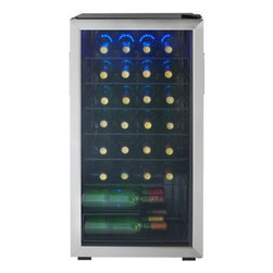 Danby - 36 Bottle Wine Cooler, Reversible Door, Tempered Glass Door, LED lights - The Danby DWC93BLSDB 36-Bottle Free-Standing Wine Cooler is an attractive and effective way to keep your wine bottles cool. Featuring room for 36 bottles, all brilliantly showcased by the blue LED interior lighting and protected from UV rays by a tempered glass door, this free-standing cooler needs no more than an outlet to function, meaning you can place it anywhere you need.