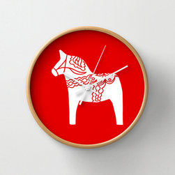 Dala Time Wall Clock - Sleek and sophisticated, but full of sweetness, the silhouette of a Dala horse gives this clock smooth seasonal style. A mix of bold red and white with natural wood embraces the horse's Scandinavian roots.
