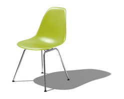 Herman Miller - Eames Molded Plastic Side Chair with 4 Leg Base - Honor the famed Eames-molded chair — not only for its artful conception — but also because it is astonishingly comfortable to sit in. The rounded shell perfectly encases your body and the high, flexible back allows you to settle in and relax for long periods of time.