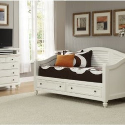 Bermuda Storage Daybed - Brushed White - Smart underbed storage and a casual yet sophisticated design make the Bermuda Storage Daybed - White a delightful choice for completing your combination home office and guest room. This stylish daybed is built of mahogany solids and engineered wood finished in fresh white. Its turned feet and curved details bring classic style. Shutter details give it a laid back island feel. Two full-extension drawers with side-mounted guides and antiqued brushed nickel hardware add charming functionality. Make the room complete by adding the optional matching Bermuda Media Chest. Four large drawers offer traditional storage and the top is felt-lined. Your flat panel TV goes on top and the open space below is for media components.Furniture Dimensions:Daybed: 82W x 43D x 44H in.Optional Chest: 36W x 16D x 42H in.About Home StylesHome Styles is a manufacturer and distributor of RTA (ready to assemble) furniture perfectly suited to today's lifestyles. Blending attractive design with modern functionality, their furniture collections span many styles from timeless traditional to cutting-edge contemporary. The great difference between Home Styles and many other RTA furniture manufacturers is that Home Styles pieces feature hardwood construction and quality hardware that stand up to years of use. When shopping for convenient, durable items for the home, look to Home Styles. You'll appreciate the value.
