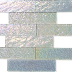 "Neve Winterscape Glass Tile - Neve Winterscape 2x8 Glass Tile This glass tile will provide endless design possibilities from contemporary to classic. It creates a great focal point to suit a variety of settings. Using a subway tile as a back splash will add style and color to your kitchen decor or any decorated room in your home. It will also give it a more distinct look. The natural material will have a color variation. . Chip Size: 2""x8"" Color: Iridescent White Material: Glass Finish: Tumbled Sold by the Square Foot- 9 pieces per sq. ft. Thickness: Please note each lot will vary from the next."