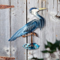 Heron Indoor / Outdoor Light Reflective Wall Art - Experience a whole new dimension in art with the Heron Indoor / Outdoor Light Reflective Wall Art! Refraxion pieces are laser cut from 18-gauge steel, powder-coated for rust resistance and durable enough to be used indoors or outdoors. Each piece is hand crafted. Each Refraxion piece has brackets on the back that allow the art to hang away from the wall. Plus, they're designed with pieces that can be bent out to provide a 3-dimensional effect. This work of art is proudly made in the USA.About Next InnovationsWith their company headquarters and manufacturing facility in the beautiful north woods of Walker, Minnesota, Next Innovations employs an in-house design team and all products are engineered and produced on site. They are a young, innovative company specializing in decorative home decor, gift store, and garden products. They have developed high-quality steel products with various finishing treatments making every product superior to others in the market. Next Innovations categories include: RefraXions, Art 2, EyeCatchers, Terra Decor, Plant Hangers/Wall Brackets, and Garden Stakes. Next Innovation's products are primarily created from 18-gauge cold rolled steel, acid washed and powder coated for added rust-resistance. Color is applied through an infusion process to create a finish that won't fade or flake.