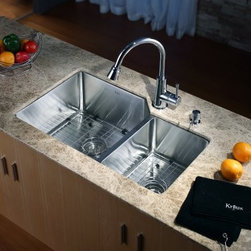 Kraus KHU123-32-KPF2220-KSD30 Double Basin Undermount Kitchen Sink - Your kitchen will be cooking right along with the Kraus KHU123-32-KPF2220-KSD30 Double Basin Undermount Kitchen Sink and its innovative and elegant construction. An arching faucet easily switches from normal flow to strong spray with the push of a button. The pair of stainless steel basins makes for easy multitasking to your delight.Product SpecificationsNumber of Basins: 2Bowl Depth (inches): 10Weight (pounds): 34Low Lead Compliant: YesEco Friendly: YesMade in the USA: YesHandle Style: LeverValve Type: Ceramic DiscFlow Rate (GPM): 2.2Spout Height (inches): 8.25Spout Reach (inches): 9.25About KrausWhen you shop Kraus, you'll find a unique selection of designer pieces, including vessel sinks and faucet combinations. Kraus incorporates its distinguished style with superior functionality and affordability, while maintaining highest standards of quality in its vast product line. The designers at Kraus are continuously researching and exploring broader markets, seeking new trends and styles. Additionally, durability and reliability are vital components at Kraus for developing high-quality fixtures. Every model undergoes rigorous testing and inspection prior to distribution, with customer satisfaction in mind. Step into the Kraus world of plumbing perfection. With supreme quality and unique designs, you will reinvent how you see your bathroom decor. Let your imagination become reality!
