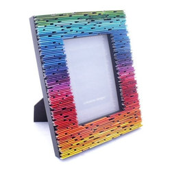 Gradient Picture Frame Made From Recycled Magazines by Colorstory Designs - I'm a total sucker for ombré. Even though this frame isn't just one color ranging from light to dark, the rainbow ombré effect has got me swooning! This would be the perfect surrounding for a photo of you and your sweetie.