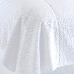 Biscayne Blanket Cover - Cal-King - Whether you're balancing boldly-hued bedroom walls or curating a white-on-white paradise, the Biscayne Blanket Cover lends an extra layer of dimension to your bedding arrangements and seasonal versatility to your sleeping hours. This imported seersucker blanket cover is beautifully stitched and woven entirely from machine-washable cotton.