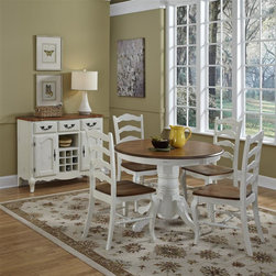 HomeStyles - Oak and Rubbed White 5 Piece Dining Set - Includes table and 4 chairs. The 5PC Dining Set is constructed of hardwood solids and engineered wood in a distressed oak and heavily rubbed white finish. The oak top features several distressing techniques such as worm holes, fly specking, and small indentations. Seat features a contoured seat for comfort. Set includes one pedestal dining table and four dining chairs. 42 inch round table. Assembly required. Table size: 42 in. W x 42 in. D x 30 in. H. Chair size: 18.75w 21.5d 40h.