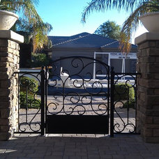 Mediterranean Home Fencing And Gates by Ironic Metalworks LLC