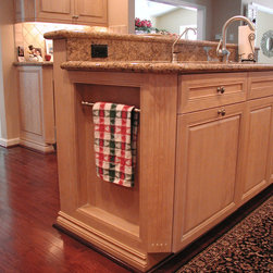 Cabinet details & specialty cabinets - A recessed hanging towel bar.