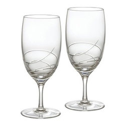 Waterford Ballet Ribbon Essence 19 oz. Iced Beverage Glass - Set of 2 - Fill the Waterford Ballet Ribbon Essence 19 oz. Iced Beverage Glass - Set of 2 with refreshing iced tea, chilled water, or a dramatic cocktail to keep cool on those warm summer days. This set of two fine crystal glasses are part of the Ballet Ribbon Essence Collection, which owes its contemporary look to a fanciful interpretation of silk and satin ribbons that caress a dancer's costume and precious pointe shoes.About WaterfordWaterford is the world's most coveted name in crystal. Rich in history, this company was founded in 1783 by William and George Penrose in the heart of the Irish harbor town of Waterford. Throughout the generations, they have become known worldwide for creating crystal and glass drink ware, crystal gifts, and home accessories of unsurpassed beauty and quality. From the Waterford Lismore, the most famous Waterford pattern, to innovative contemporary patterns, Waterford items are instant heirloom pieces everyone will treasure.