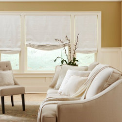"Boutique Relaxed Roman Shade - Our Relaxed Roman Shade redefines beauty and can introduce elegance into any room. These relaxed shades have a slight bend, or ""smile"", at the bottom of the material instead of the creased, folded look of classic Romans. When lowered, this delicate shade will lay flat against your window and maintain its gentle curve. This Relaxed Roman Shade will also include an easy-to-use cordless system that provides a clean look."