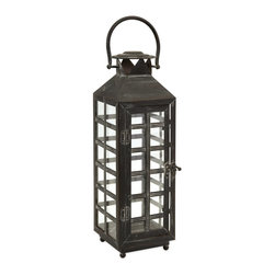 iMax - iMax Drake Tall Candle Lantern X-42365 - Create a warm and inviting ambiance with this IMAX Drake tall candle lantern. This incredible, oriental-style piece, with the straight lines of the wrought iron frame that create small, square window panes and topped with a handle, will look good alone or in groups of two or more. Once you place a lit pillar candle inside, it will surely stand out in any space.