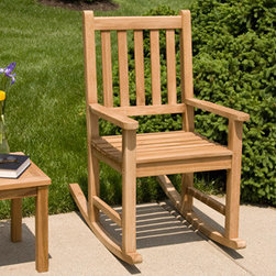 Joanne Teak Rocking Chair - Enjoy a lovely summer day on your front porch, sitting in this beautiful Joanne Teak Rocking Chair. Pair with other teak wood furniture for a coordinated look.