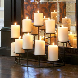 Holly & Martin - Holly & Martin Preston Candelabra - Candles not included. Holds ten candles. Two rows, five platforms in the front and five platforms in the back. Each platform is 3 in. Dia.. Sturdy base. Made from metal. Black matte color. No assembly required. 21.5 in. W x 10 in. D x 11 in. H (6 lbs.)This glamorous metal candelabra is the perfect feature to adorn any shelf or mantel. With ten platforms to hold candles, this metal candelabra will add warmth and a gentle glow to any room in your home.