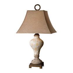 Uttermost Fobello Ivory Table Lamp - Distressed, crackled ivory ceramic with tan undertones, rustic accents and dark bronze details. Distressed, crackled ivory ceramic with tan undertones, rustic accents and dark bronze details. The square bell shade is a rusty linen fabric.