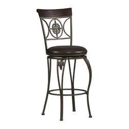 Linon - Fleur De Lis Upholstered Swivel Stool in Dark - Choose Seat Height: 24 in.Fleur De Lis Collection. Swivel seat. Cushion is piled high for extra comfort and covered in a distressed Brown wipe clean vinyl which is resistant to everyday wear and tear. Wipe clean distressed Brown PVC seat cover. Crafted of metal and highlighted with subtle curves and a distinctive back. 275 lbs. Weight limit. Minimal assembly required. 17 in. W x 20 in. D x 40 in. H, Seat height: 24 in.. 17 in. W x 20 in. D x 46 in. H, Seat height: 30 in.The elegance and unique style of this Fleur De Lis Stool will carry throughout your kitchen, dining, or home pub area. This stool is a positively striking addition to your home. This stool is versatile for any gathering area. Finished in Dark Antique Gold with a Brown wood accent.
