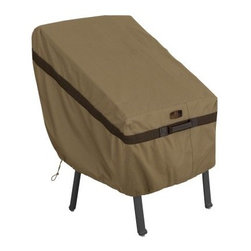Classic Accessories Hickory Adirondack Chair Cover - Tan - The Classic Accessories Hickory Adirondack Chair Cover - Tan is a handsome way to protect your Adirondack chair. This cover is made of Weather10 material in classic tan and is accented by Weather Leather trim that looks like real leather yet withstands the elements nicely. Padded handles ensure easy on and off. Large air vents prevent wind lofting and mildew. For a secure fit, this cover uses a combination of click-close straps and an adjustable elastic hem cord. It comes with a waterproof, laminated liner and is designed to fit most Adirondack chairs. It includes a manufacturer's limited lifetime warranty.About Classic AccessoriesFounded from small beginnings, Classic Accessories has grown in the past 30 years from a small basement operation in Seattle's Roosevelt neighborhood making seatbelt pads and steering wheel covers, to a successful and expanding company now making a wide variety of products from car to boat covers and much more. Innovative, stylish designs define products that are functional and made to last. From little details to the largest innovations, Classic Accessories is always moving forward and looking to provide cover and storage solutions to a clientele that has a passion for the outdoors, from backyard gatherings to exciting camping trips, Classic Accessories provides the products that keeps your equipment looking great all season long.