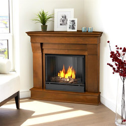 Real Flame - Chateau Corner Ventless Gel Fireplace in Espr - Uses clean burning Real Flame Gel fuel emitting up to 9,000 BTUs of heat per hour lasting up to 3 hours. Includes: Mantel, firebox, hand painted cast concrete log, and screen kit. Solid wood and veneered MDF construction.. Uses Only Real Flame 13oz Gel Fuel Cans, not included. Assembly Required. 40.9 in. W x 25.3 in. D x 37.6 in. H (65.4 lbs.)The Chateau Corner Fireplace features the clean lines and classic styling familiar to stone mantels, realized in wood. In three great finishes, this design is sure to compliment a variety of decor, from the classic to contemporary. The hand-painted log set and bright crackling flame add to the realistic look of this Real Flame Gel Fuel Fireplace. Uses 3-13oz cans of Real Flame Gel Fuel, not included