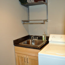 Transitional Laundry Room by Ohana Construction Inc