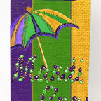 Caroline's Treasures - Mardi Gras Second line umbrella Michelob Ultra Koozies for slim cans 8373MUK - Mardi Gras Second line umbrella Michelob Ultra Koozies for slim cans 8373MUK Fits12 oz. slim cans for Michelob Ultra, Starbucks Refreshers, Heineken Light, Bud Lite Lime 12 oz., Dry Soda, Coors, Resin, Vitaminwater Energy, and Perrier Cans. Great collapsible koozie. Great to keep track of your beverage and add a bit of flair to a gathering. These are in full color artwork and washable in the washing machine. Design will not come off.