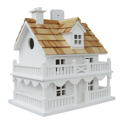 """Home Bazaar Inc - Novelty Cottage Birdhouse - Pine shingles top this classic avian residence now available in bright WHITE. The fully, functional birdhouse features a removable back wall for easy cleaning with a 1 1/4"""" side entry hole to a single, unpainted nest box plus ventilation and drainage holes. A convenient, swing-up paddle-board attached to the back allows you to hang this beautiful birdhouse anywhere. Constructed of kiln-dried hardwood."""