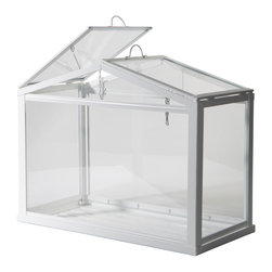 Socker Greenhouse - Yes, apartment dwellers can still enjoy some plants at home! Create a mini indoor garden with this affordable greenhouse. It's a great way to add some color and life to a minimalist sideboard.