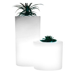 Home Infatuation - Tubini Lighted Indoor-Outdoor Planter - Put on your very own light show with this ingeniously designed indoor-outdoor planter. It can be set to continuously rotate through eight different hues (including white) or you can program it to display only one color.