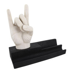Zeckos - Rock on Hand Cell Phone and Pen Holder Desk Art - Add some artistic style to your desk with this cool phone and pen holder. It features a miniature sculpture of a white hand forming making the heavy metal 'Rock On' gesture on top of a black tray that holds your smartphone and favorite pen. Made of cold cast resin, it measures 5 1/2 inches tall, 6 inches long, and 2 1/4 inches deep. This piece makes a great gift for musicians and fans of rock music.
