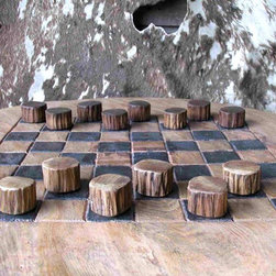 Groovy Stuff - Teak Wood Checker Set - Who can turn down a game of checkers?  This Teak Wood Checker Set is great for amateurs and practiced players alike.  The beauty of these pieces lies in the antique appearance of the teakwood.  This set gives the illusion of having been used time and time again. * Who can turn down a game of checkers?  This Teak Wood Checker Set is great for amateurs and practiced players alike. The beauty of these pieces lies in the antique appearance of the teakwood. This set gives the illusion of having been used time and time again. Board Not Included. Pieces: 1 in. x 1 in.  x 1 in.. Reclaimed teakwood furniture creates this great rustic look. Bring a bygone era of farm plows & wagons to your home or business. Each unique piece is suited for both indoor and outdoor use. Please Note: Due to the unique nature of each piece of wood and the materials used, no two items are exactly alike. These items can vary in dimension, weight and color from the shown image and the listed information