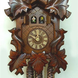 Schneider Cuckoo Clocks - 1-Day Musicman Carved Cuckoo Clock - Two doors. 1-day rack strike movement strike movement. Cuckoo calls and strikes every half and full hour. Wooden cuckoo, dial with roman numerals and hand. Shut-off lever on left side of case, silences the strike, call and music. Made from wood. Antique finish. Made in Germany. 7.87 in. W x 6.10 in. D x 11.81 in. H (4.41 lbs.). Care Instructions