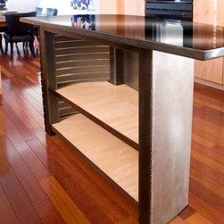 Girardini Design Modern - Modern steel kitchen island with granite counter top and hidden storage.  Photo by Ken Girardini