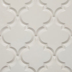 Beveled Arabesque Tile - I love seeing the clean and glamorous twist with this exotic pattern shown in a glossy white. Could work brilliantly in a modern, monochromatic space.