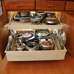 Pull Out Shelves with Dividers - Because all of our pull out shelves are custom made, choose the configuration that suits your items best.  The dividers on the bottom shelf are on either side of the main compartment to allow for additional pots and pans storage in the middle.  A single-height shelf without dividers is above.