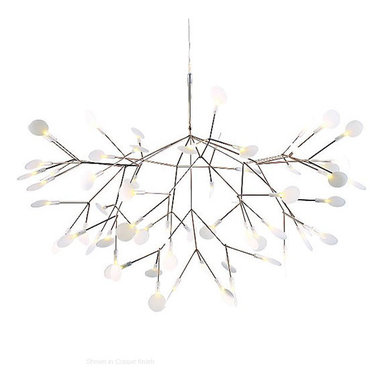 Heracleum LED Suspension by Moooi - Heracleum LED suspension was inspired by the Heracleum plant. The white leaves/lenses ramify from one branch creating a very technical, natural structure. The Heracleum leaves are not frozen in one position. They can be freely re-positioned by rotating them around their stem. Finish available in copper and nickel. Available in two sizes. Large includes 63, 3000K warm white LED lamps totaling 14 watts. Small includes 45, 2700K warm white LED lamps totaling 9 watts. General light distribution. CE listed. Small: 28.3 inch diameter by 20.9 inch height. Large: 38.6 inch diameter x 25.6 inch height.