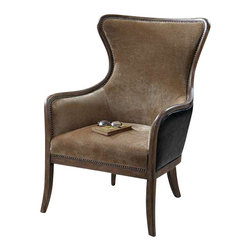 "Uttermost Snowden Tan Wing Chair - Solid wood construction with reinforced joinery and hand rubbed, weathered pine exposed frame.  Plush, caramel tan velvet is accented by solid brass nails and surrounded in deep chocolate faux leather. Solid wood construction with reinforced joinery and hand rubbed, weathered pine exposed frame. Plush, caramel tan velvet is accented by solid brass nails and surrounded in deep chocolate faux leather. Seat height is 18""."