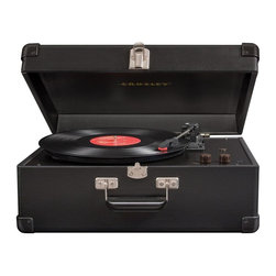 Crosley Radio - Keepsake USB Turntable in Black - USB Enabled for connection to Windows equipped PC and MAC. Software suite for ripping and editing audio content. Belt driven turntable mechanism. Plays 3 speeds - 33 1/3, 45 and 78 RPM records. Plays 7 in., 10 in. and 12 in. records. Fully automatic return tone arm. Diamond stylus needle. Auxiliary input. Adjustable robe control. Dynamic full range stereo speakers. Vinyl-wrapped. Headphone jack. RCA out. Chrome snap closure. Corner guards. Metal and Resin handle. Portable. 11 in. L x 17 in. W x 7 in. H