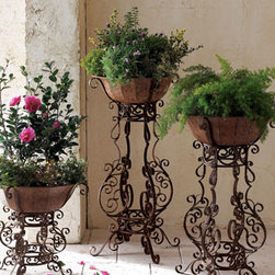 """Horchow - Tole & Iron Planter, Large - Taupe-finished tole pots atop elaborately scrolled iron stands create a striking display for flowers or greenery. Outdoor safe; develops a natural patina over time. All planters are 16""""Dia. Small, 17""""T; medium, 30""""T; large, 35""""T. Baskets shown not inclu..."""