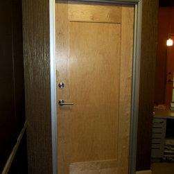 Dr. Mossey - Austin, TX - Progressive Solutions supplied flat panel maple door and Emtek hardware.