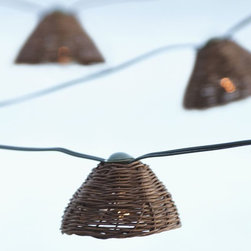 Woven Cafe String Lights - An easy way to add a bit of rattan, Pottery Barn's darling string lights are pretty day and night.
